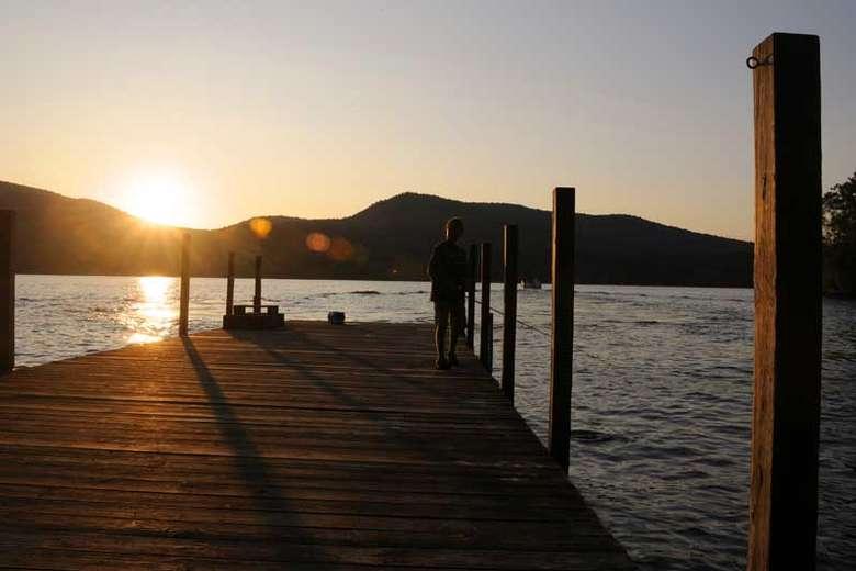 sun setting over the dock