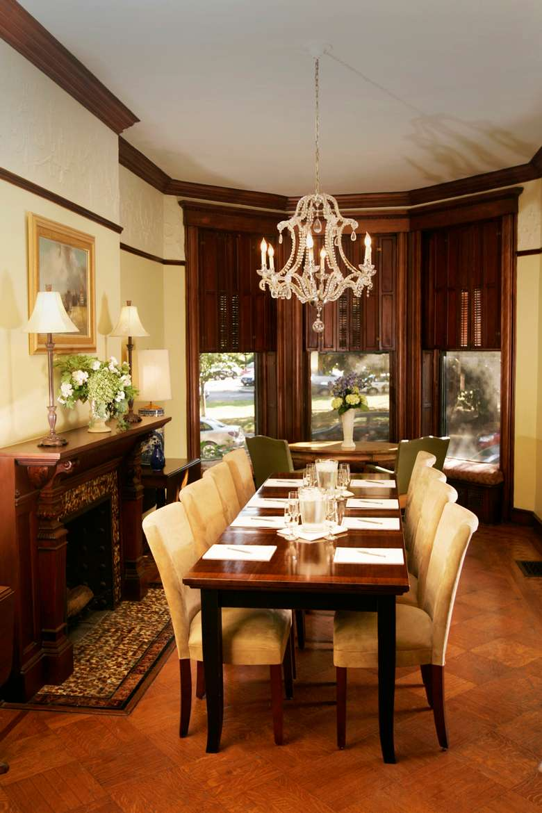 dining room in a historic mansion set up with eight chairs at the table