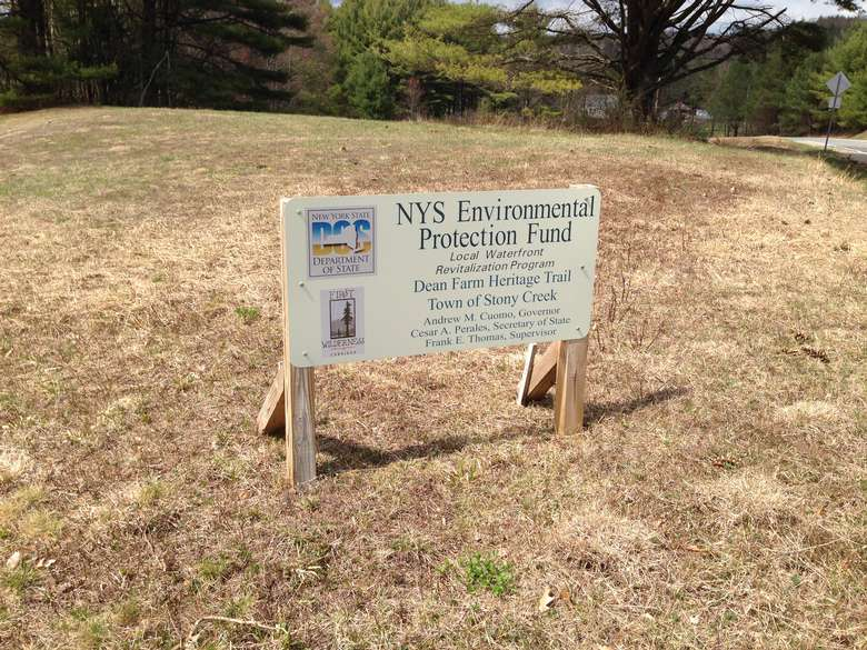 sign marking the dean farm heritage trail as part of the new york state environmental protection fund