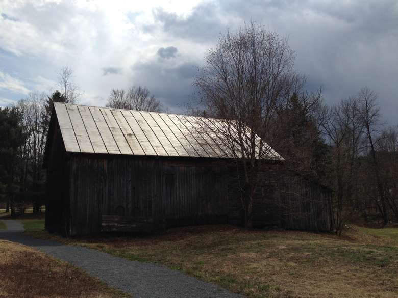small wooden building with a metal roof