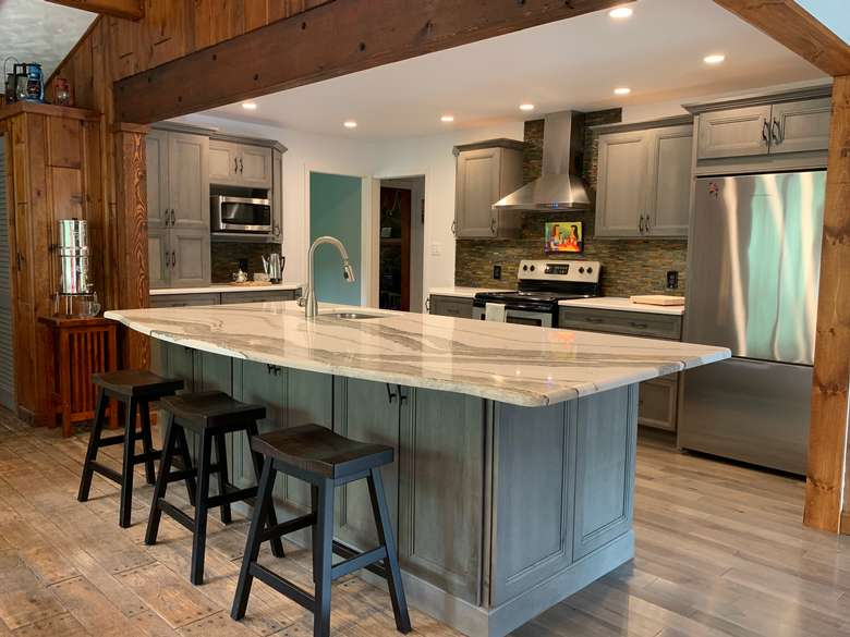 Rustic contemporary kitchen featuring Showplace Cabinetry & Cambria counter tops