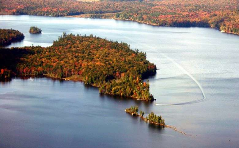 aerial view of raquette lake in the fall