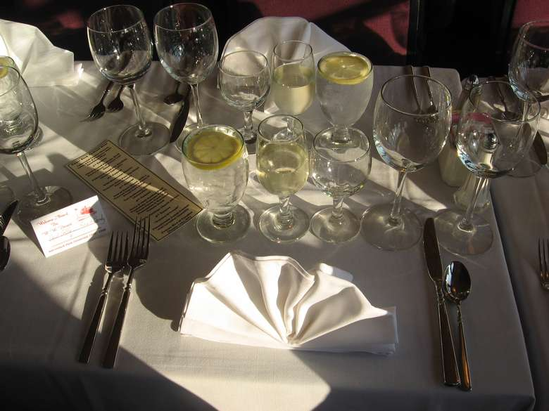 place settings at a table on a steamboat
