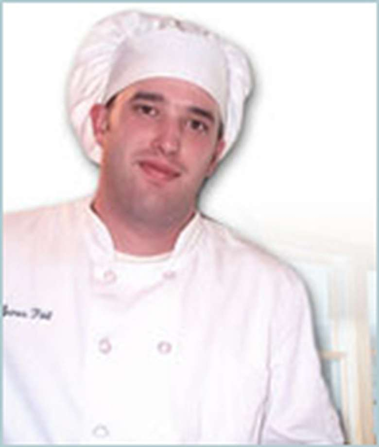 chef in a white coat and hat