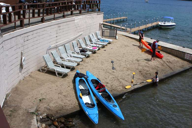 lounge chairs and kayaks in the sand