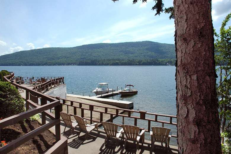 adirondack chairs on a deck overlooking lake george