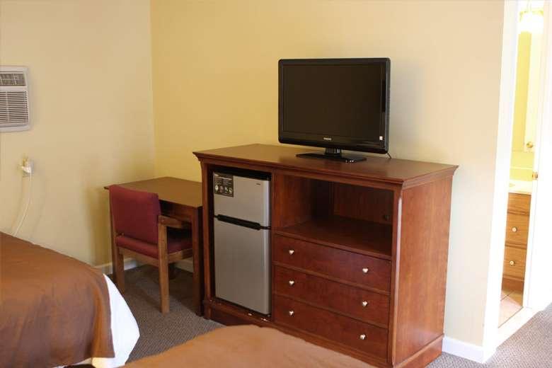 tv on dresser in a motel room