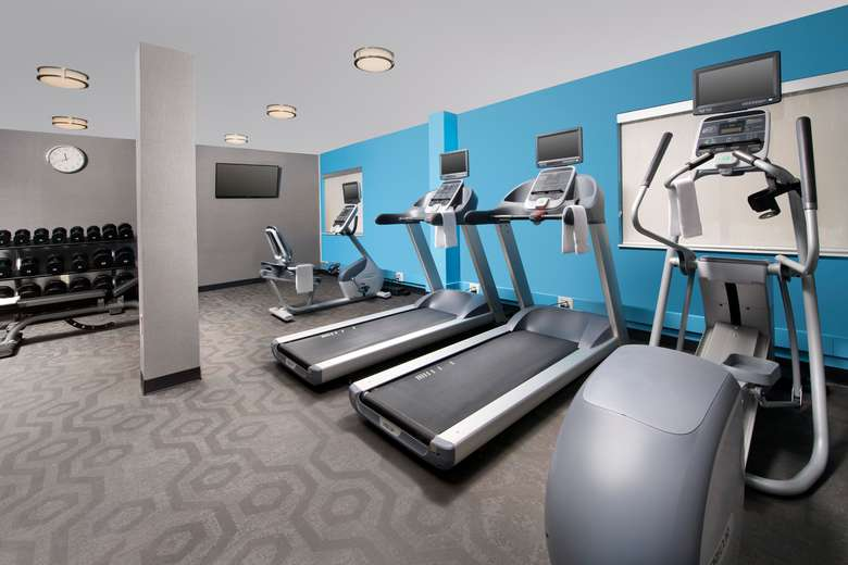 fitness room with various exercise equiptment