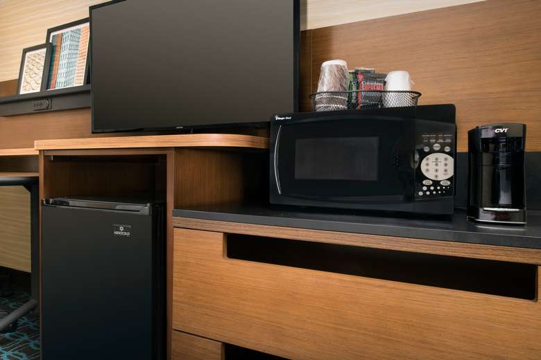 television, microwave and fridge