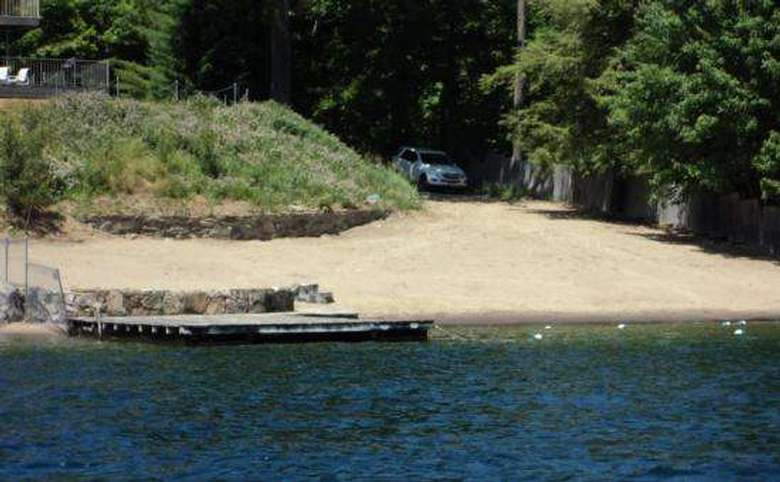 view of car on property from water