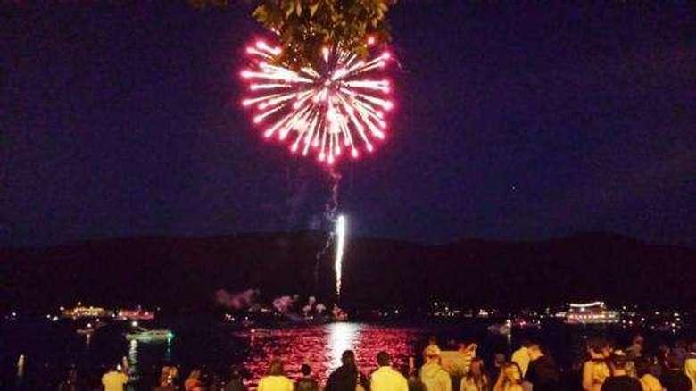 people watching pink fireworks