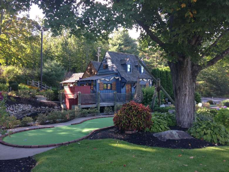 mini golf course wrapping around two houses