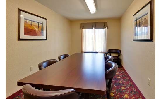 table with six chairs in a conference room