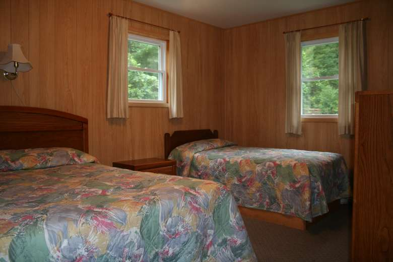 bedroom with windows, two beds