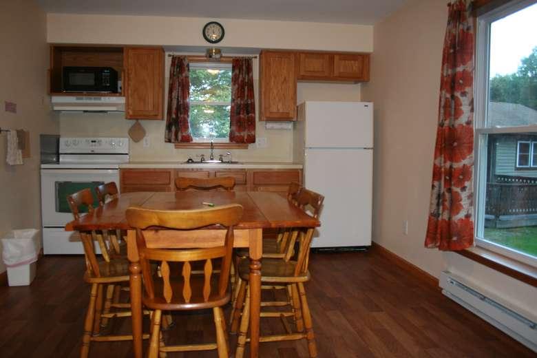 quaint kitchen, floral curtains