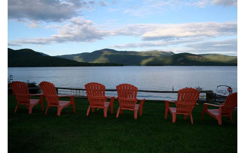 view the lake and mountains from Adirondack chairs
