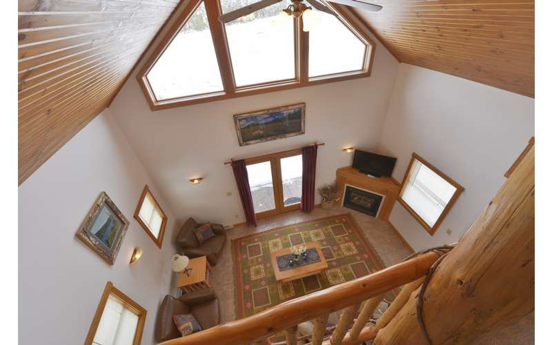 Upstairs Loft Bedroom overlooking the living room, with outstanding views.
