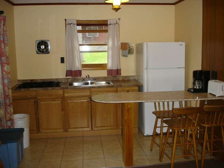 kitchen with white fridge, small table