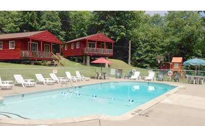 outdoor pool with cabins nearby