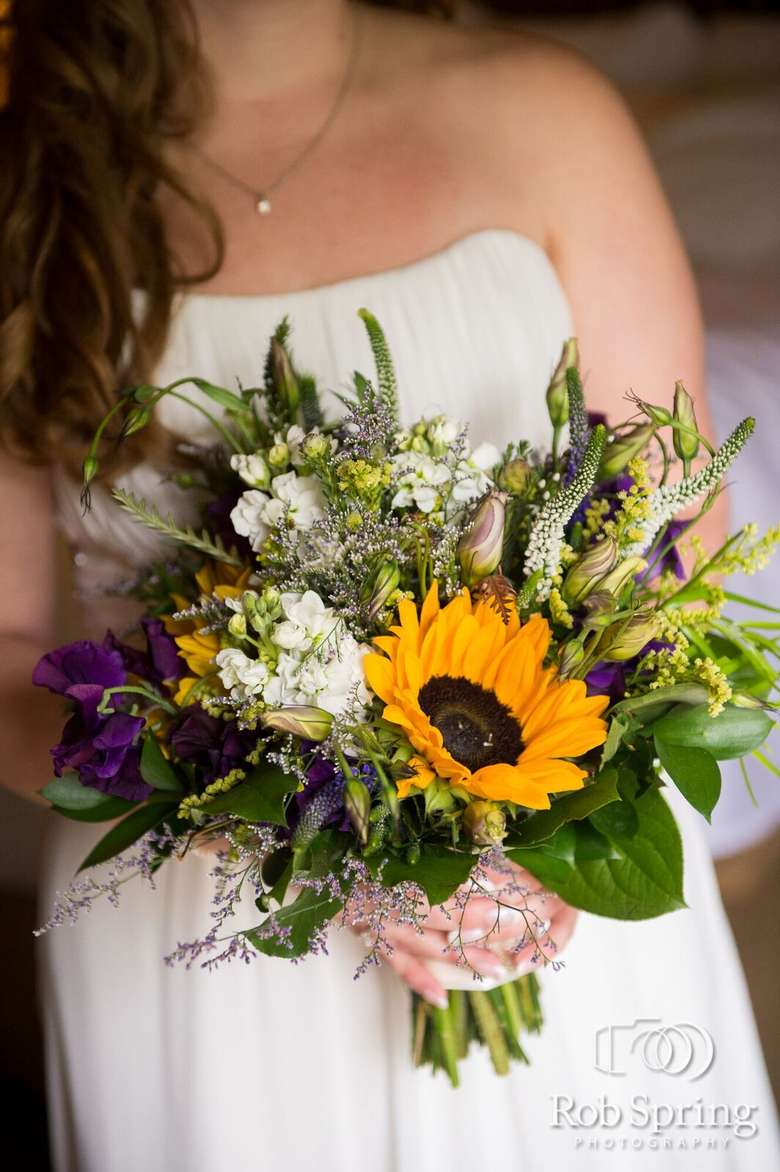 woman in a wedding dress holding a bouquet