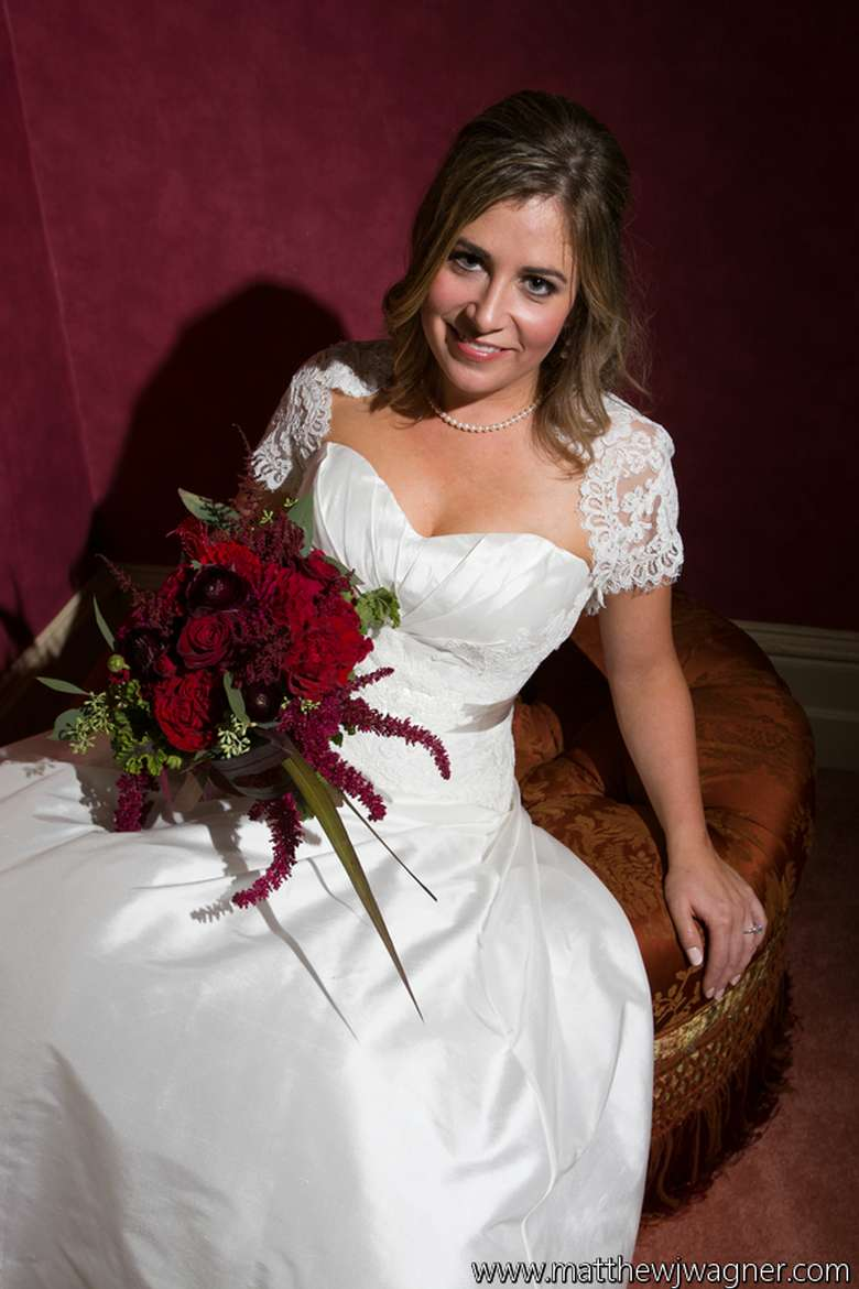 woman sitting back on a chair wearing a wedding dress
