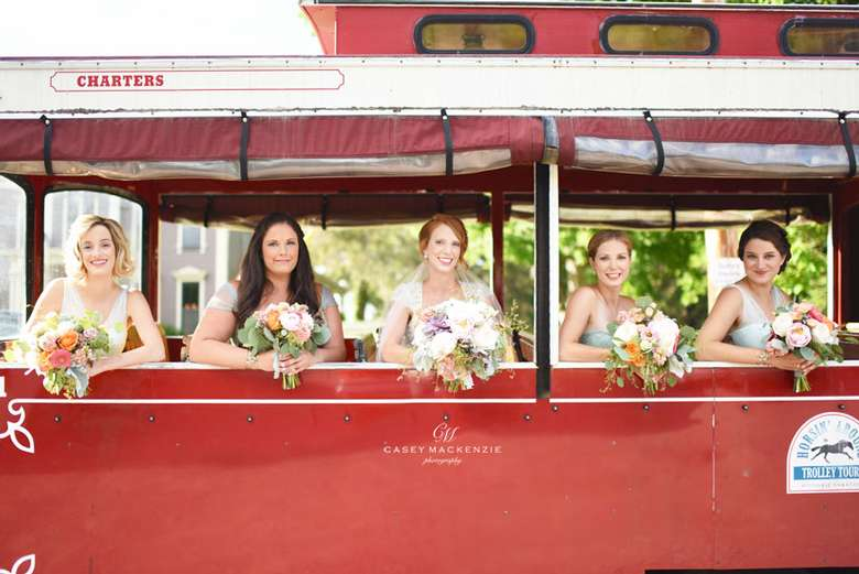 Girls on a wedding trolly looking out the windows