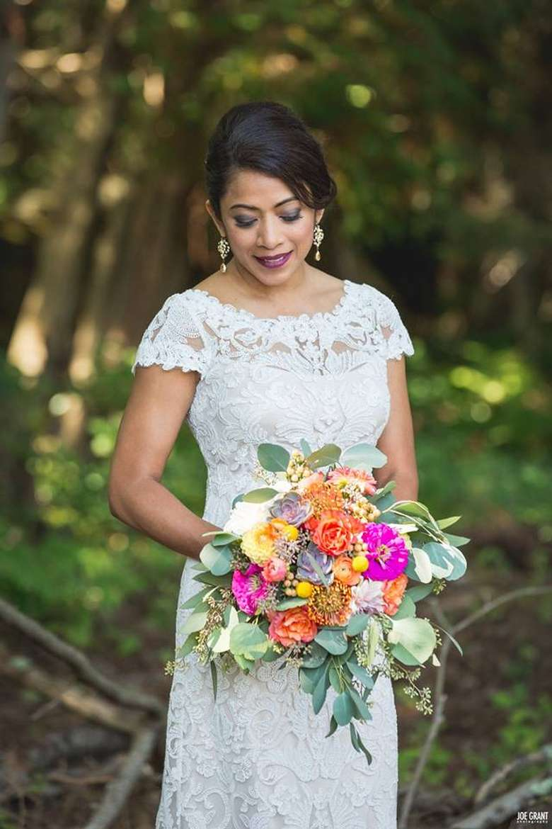 Bride holding bouquet in  nature