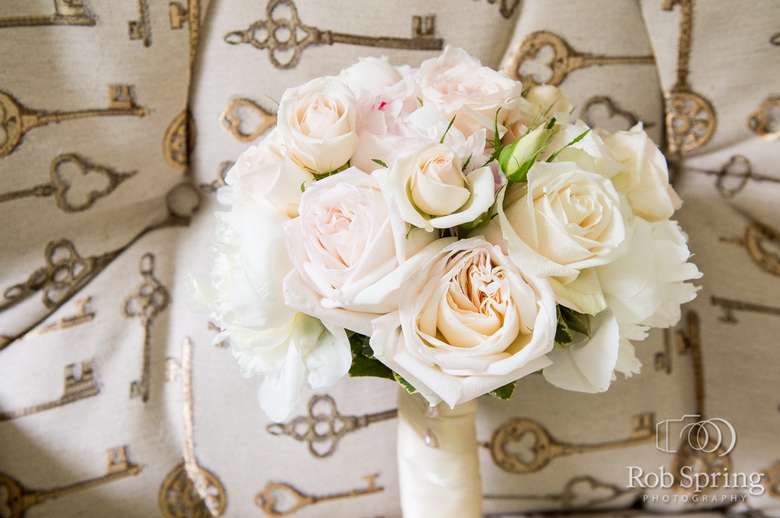 White rose bouquet with background of keys