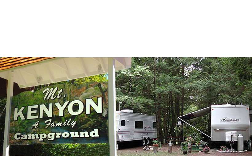 the sign for mount kenyon family campground with RVs in the background