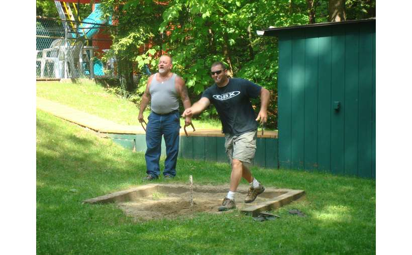 two men playing horseshoes