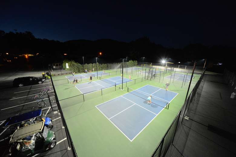 tennis or pickleball courts lit up at night