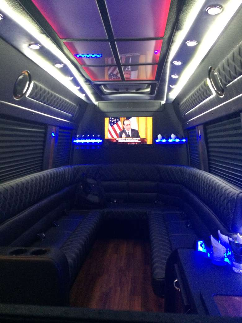 interior of an upscale van with limo-style seating