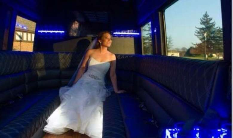 bride looking out the window of a limo-style van