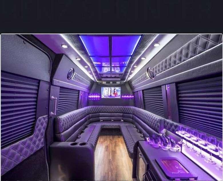 purple mood lighting in a limo-style van