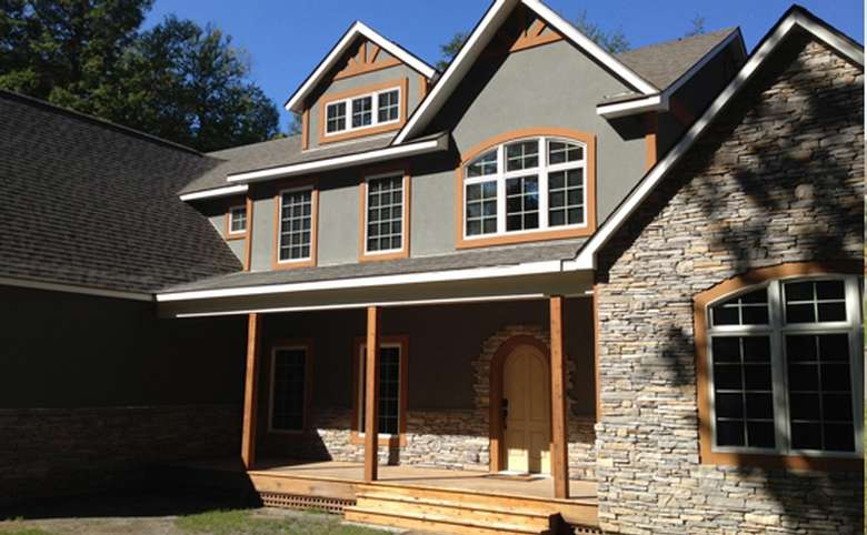 exterior of a new home with a combination of siding and stone work
