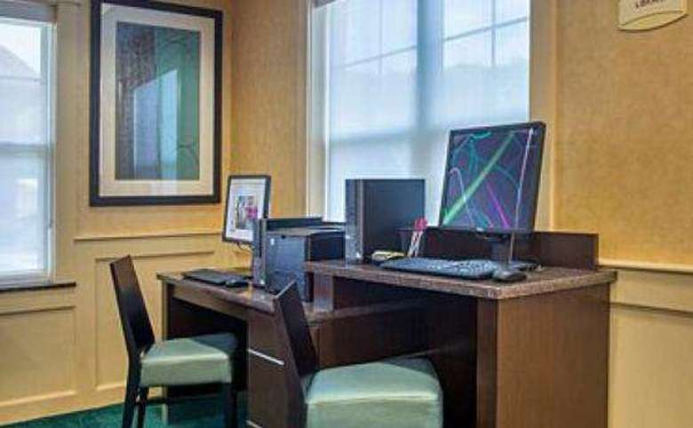business center with two computers and a printer