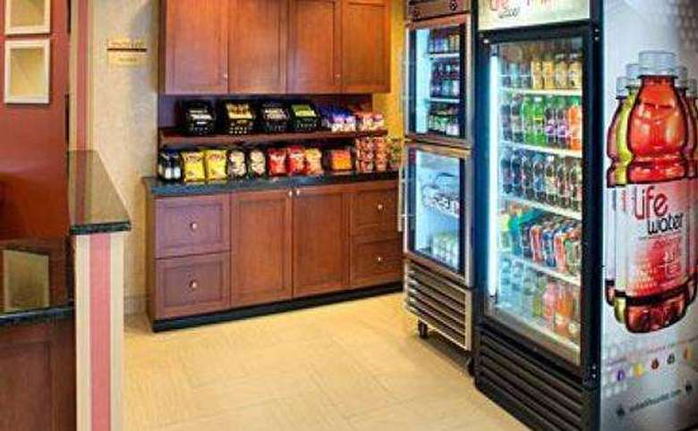 small convenience store in a hotel offering bottled drinks and snacks
