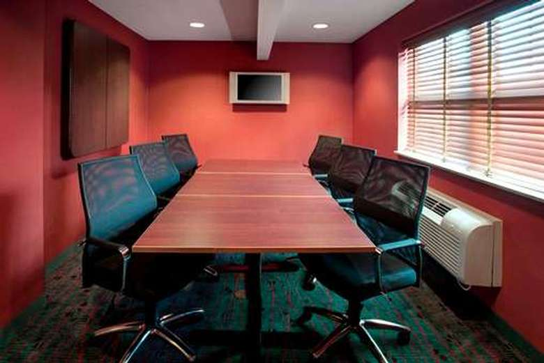 meeting room with six chairs around the table