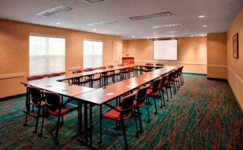 large meeting room with seating for more than a dozen people