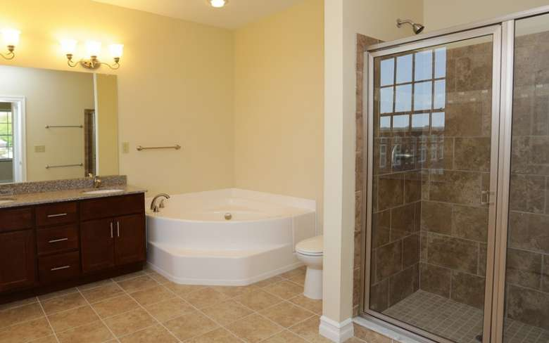Bathroom with sink, shower, toilet and tub