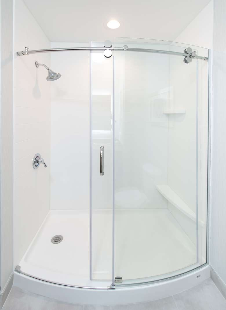 white shower with glass sliding doors