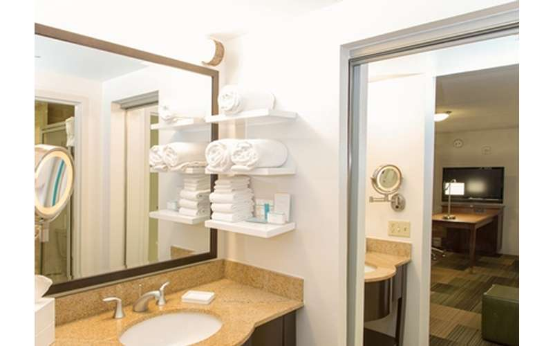 bathroom with towels on shelves