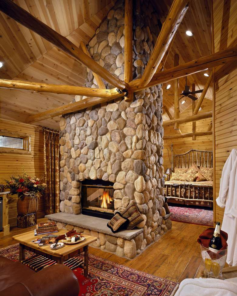 a stone fireplace with a fire