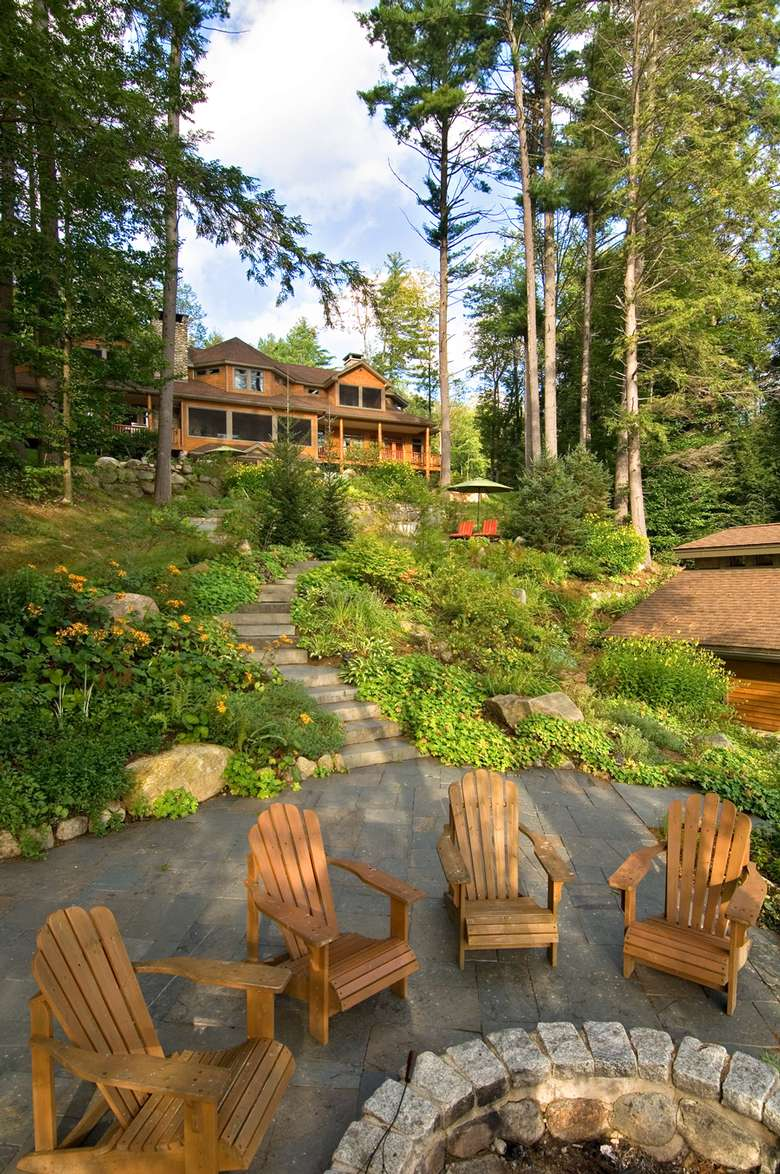 the outside of the lodge with Adirondack chairs