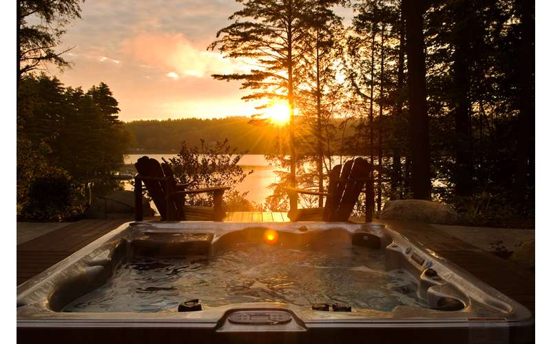 a sunset and a hot tub