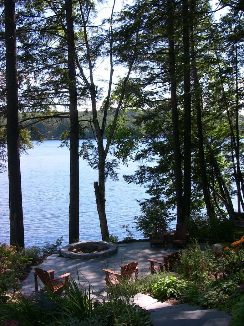 outside the lodge during the day, view of the water and trees