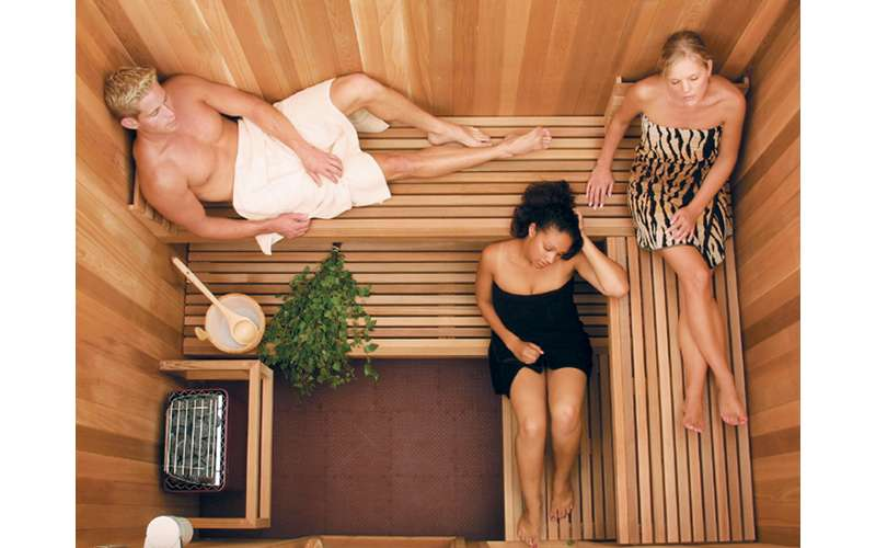 three people enjoying a sauna