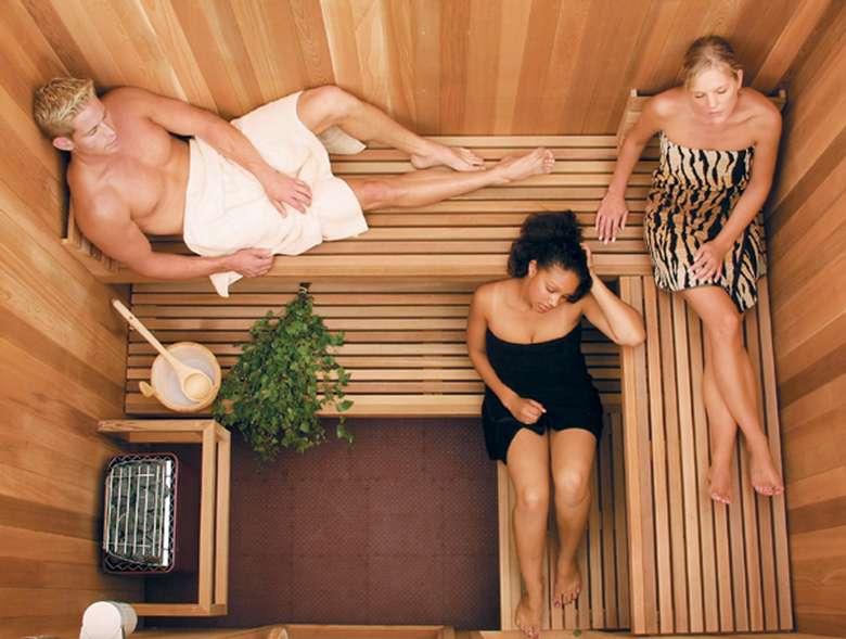 three people enjoying a sauna
