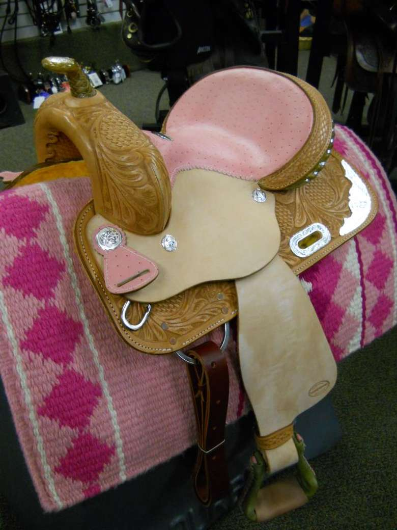 pink and brown child-sized saddle