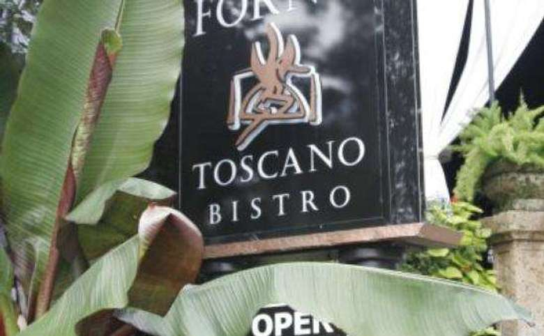 forno bistro's front sign that says forno toscano bistro